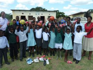 The children show off their new cloths and footballs