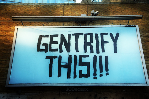 Gentrify This billboard at the Cans Festival, Leake Street, London